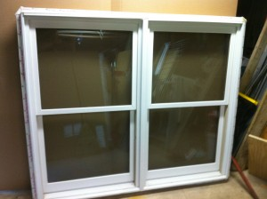 Used Double Hung, Aluminum clad, wood inside 4 9/16 jamb, 67' W x 56' H   $ 55.00